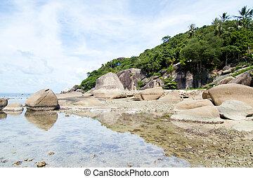 Thai island of Koh Samui. The pile of rocks on the beach
