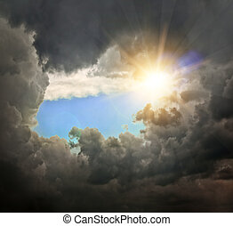 sunlight - dramatic backdrop of the blue sky with clouds and...