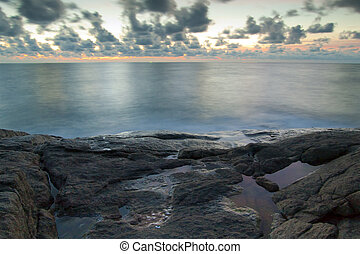eascape. Sea and rock at the sunset