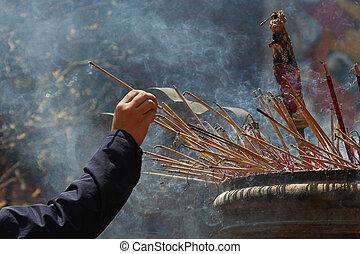 Incence sticks - Smoking prayer sticks at vietnamese pagoda