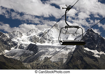 chairlift with snow mountains - chairlift in Switserland...