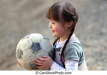 Portrait of beautiful happy girl with soccer ball