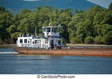 Barge - Transportation on the river with an old, rusty barge