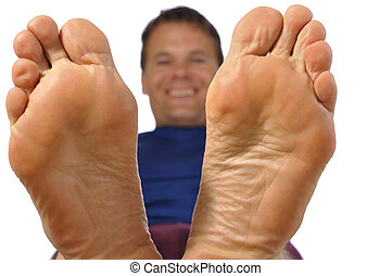 Bare feet - Closeup of bottom of feet as smiling man...