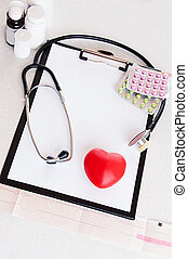 Medical heart check - Stethoscope, pills on ecg with heart,...