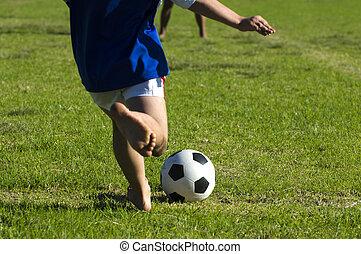 Soccer game - Children play soccer.