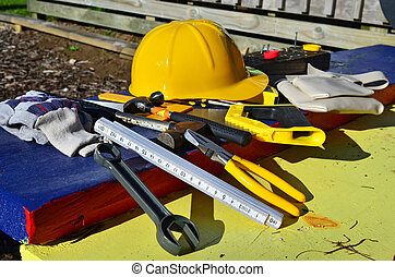 Builder tools - Builders hard hat with tools.