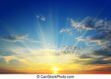the sun above the horizon - the suns rays illuminate the sky...