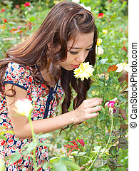 Pretty asian girl smelling a  rose