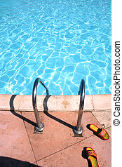 flip-flops near the swimming pool