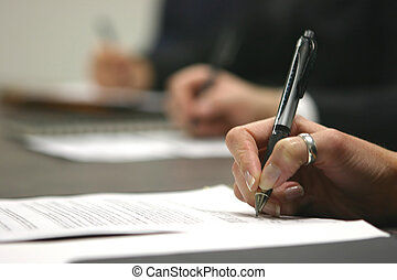 Signing contract - three hands in a row holding pen writing...