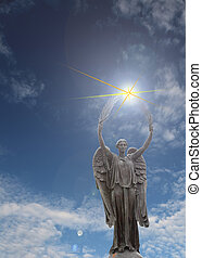 angel statue with palm branches and light rays