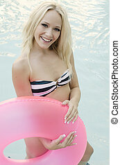 Beautiful blond woman in pool - Happy smiling young woman...