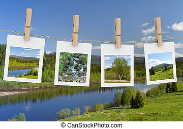 Landscape photographs hanging on clothesline. 3D image