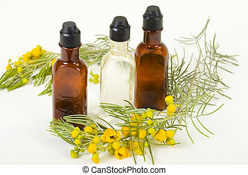 Three Bottles Of Hygienic supplies With Fresh Flower Twig