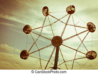 sky wheel - a spidery wheel tosses riders into the sunset...