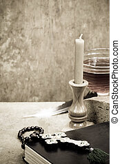 Holy Scriptures, candle and vine on wood