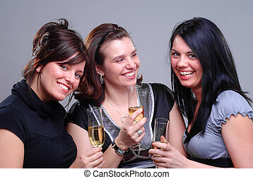 Party Time - Three Young Women Enjoying Champagne At A Party