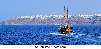 Tourists boat going to Oia, Santorini, Greece - Panoramic...
