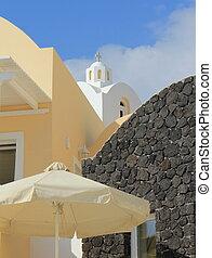 Church behind house, Santorini, Greece