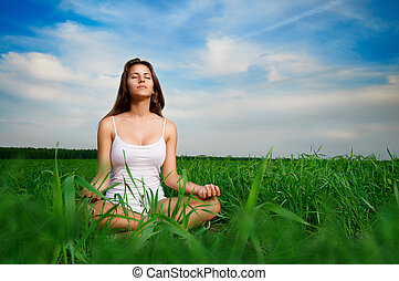 girl enjoying summer - beautiful girl relaxing in a field