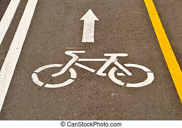 Bicycle sign on asphalt road