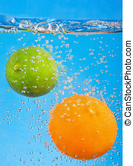 citrus fruits fall into the water