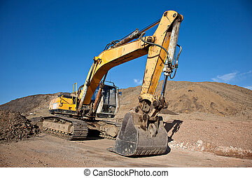 Excavator at a construction site with blue sky