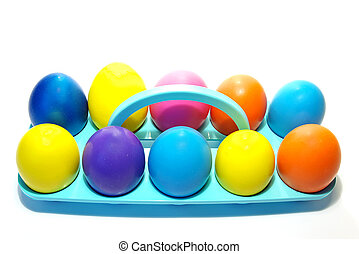 Easter holiday eggs - Easter holiday. Color eggs in a tray...