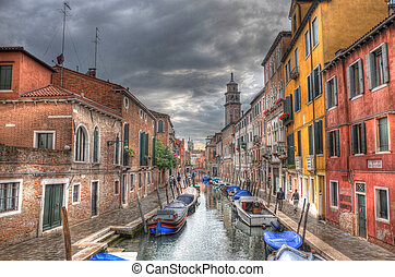Canal in Venice with ancient houses, and boats, Venice,...