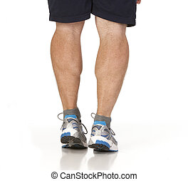 Runner stretching calf muscles of legs. Isolated against...