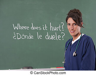 Nurse teacher translating English to Spanish on chalkboard...