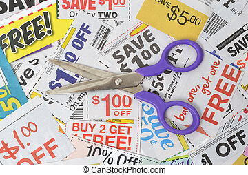 Coupons Pile - pair of scissors on grocery coupons