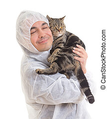 man in protective clothing holding a cat, isolated - Young...