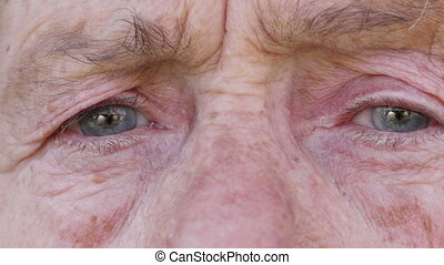 Face of old woman - Wrinkled face of old woman