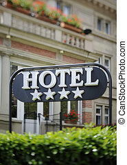 Hotel sign - Detail of a four stars hotel with beautiful...