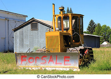 "For Sale - A small bulldozer with the words ""For Sale""..."