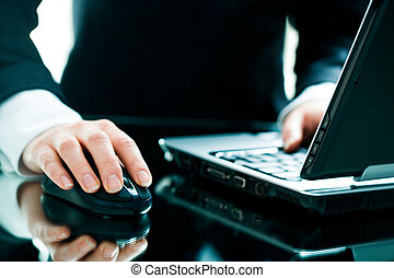 Hand on the mouse - Image of businesswoman�s hand on...