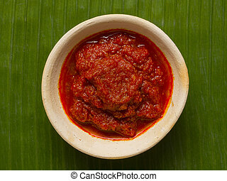 sambal chili sauce - close up of a bowl of sambal chili...