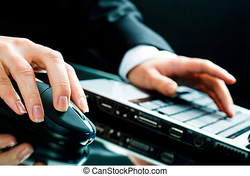 Working with laptop - Image of human hands working on the...