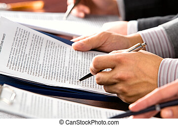 Business seminar - Image of people�s hands making notes in...
