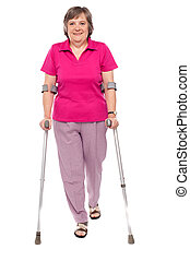 Full length portrait of an injured senior woman isolated...