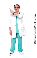 Full length image of doctor indicating up - Full length...