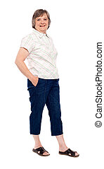 Old lady posing with hands in pocket Full length shot