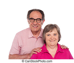 Happy senior love couple posing against white background