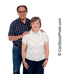Aged love couple posing with smile Male resting hands on her...