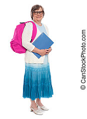 Its school time again. Full length portrait of an aged woman...