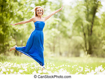 happy woman - happy young blond woman outdoor on a summer...