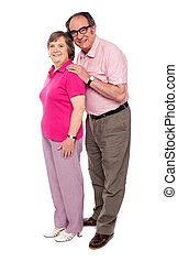 Full length portrait of matured love couple Man embracing...