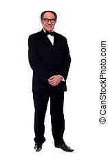 Attractive senior man posing in tuxedo isolated over white...